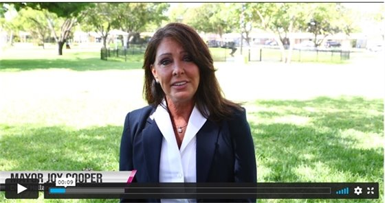 Mayor Joy Cooper in a video with grass behind her