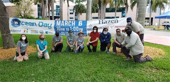 staff and volunteers in front of ocean day banner