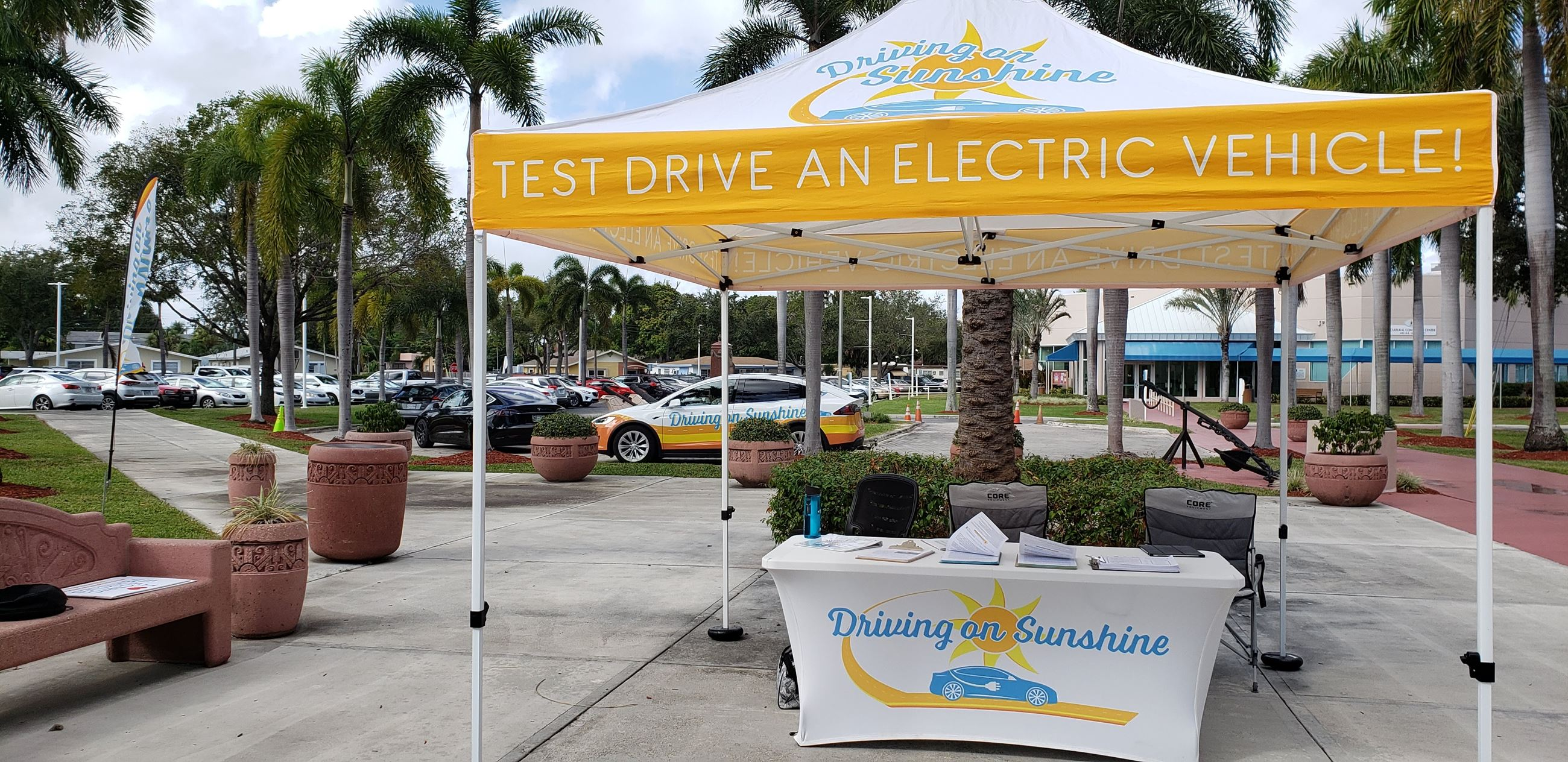 pop up tent that says test drive an electric vehicle